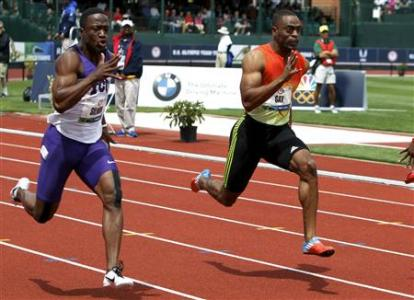 Tyson Gay and Charles Silmon compete in the men's 100 metre semi-final at the U.S. Olympic athletics trials in Eugene